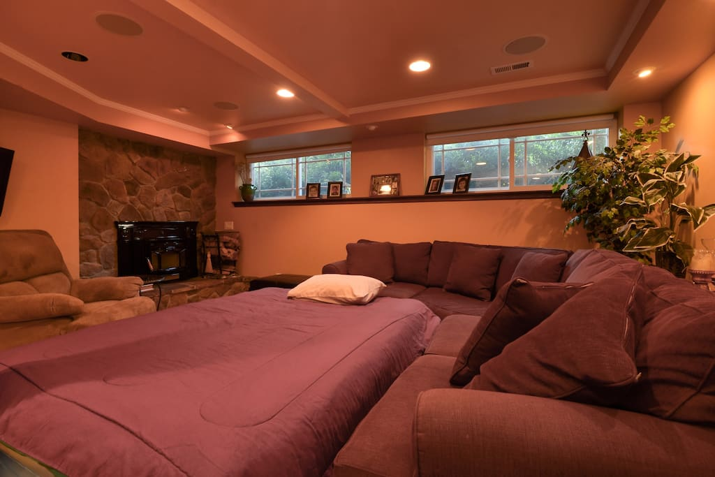 Couch, air bed, recliner, wood-burning fireplace, and privacy with daylight (from another angle.)