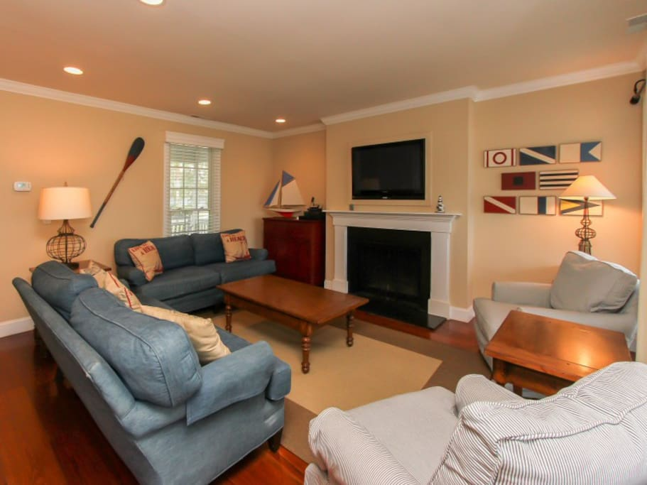 Living Room with Screen Porch Access at 15 Lands End Road