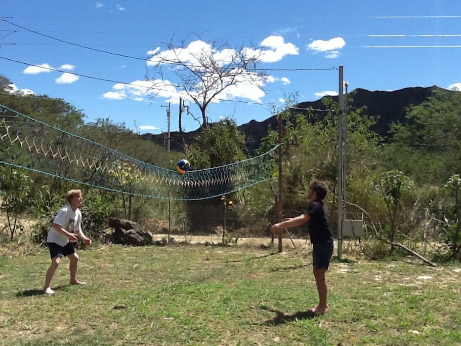 Airbnb guests playing volleyball on the property