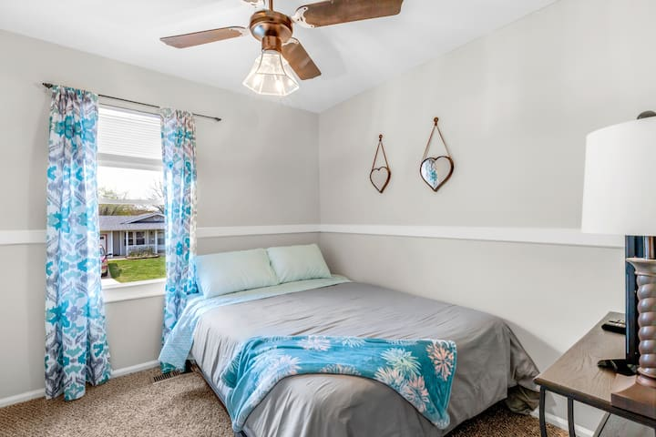 Bedroom #3 on main level with extremely comfortable queen bed set, smart TV, spacious closet, ceiling fan.