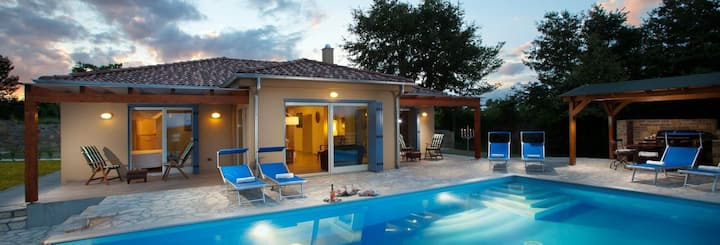 Villa Principe with a pool in the hilltop of town.