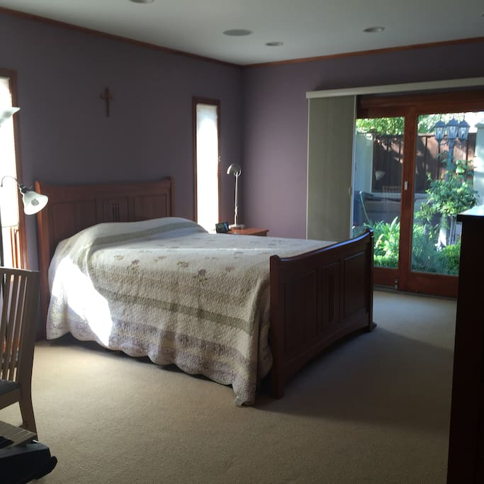 Spacious 17 x 13  Master bedroom furnished with Comfy Pillow top queen bed, night stand and chest of drawers. Sliding Glass door is private entrance leading to beautiful patio.