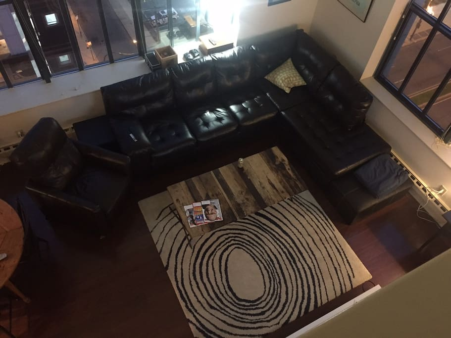 Big leather couch, cool rug, cool.