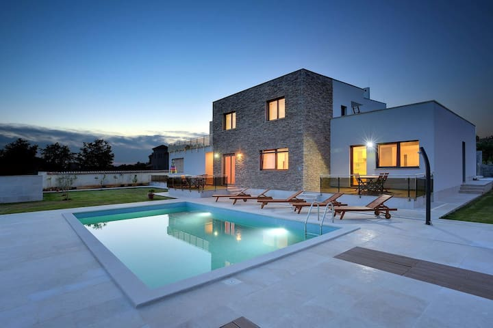 Modern villa consisting of two apartments with private pool, beach at 1 km