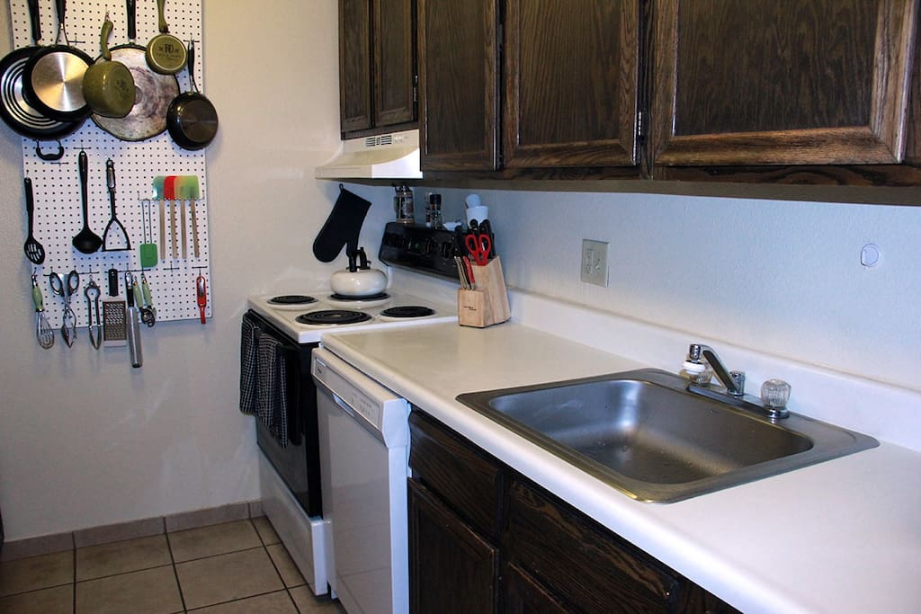 Fully stocked with dishes, pantry and cleaning supplies.