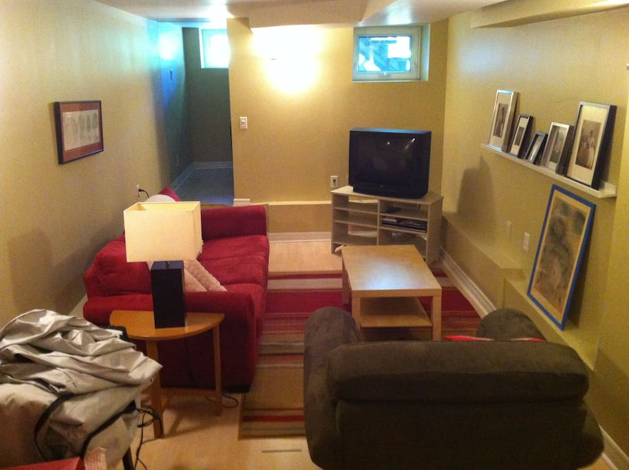 Full basement apartment includes couches and TV