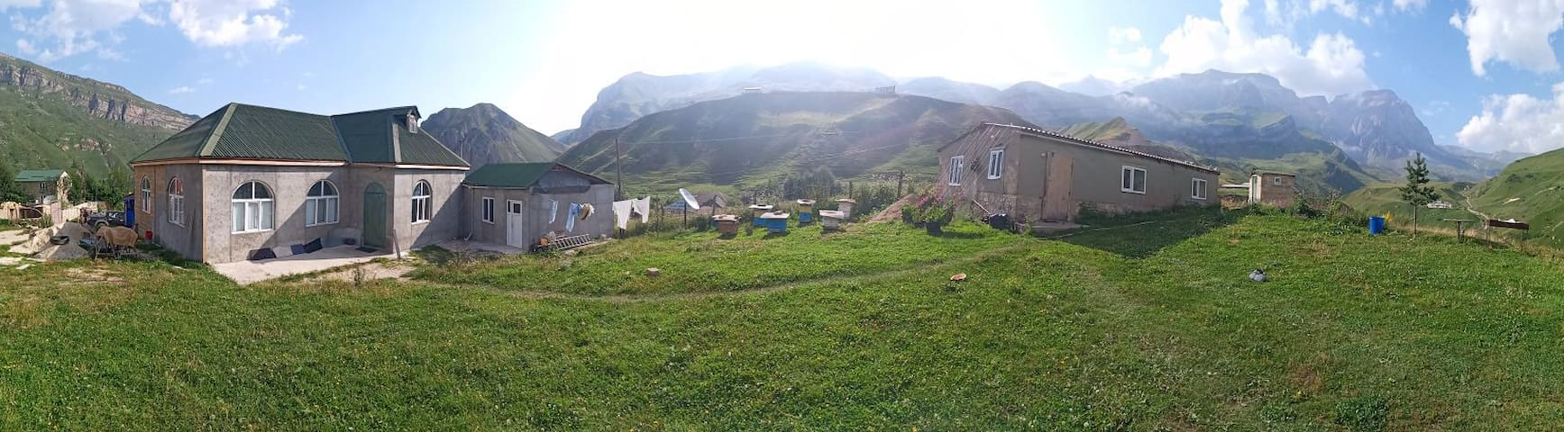 Village house between the Caucasus mountains