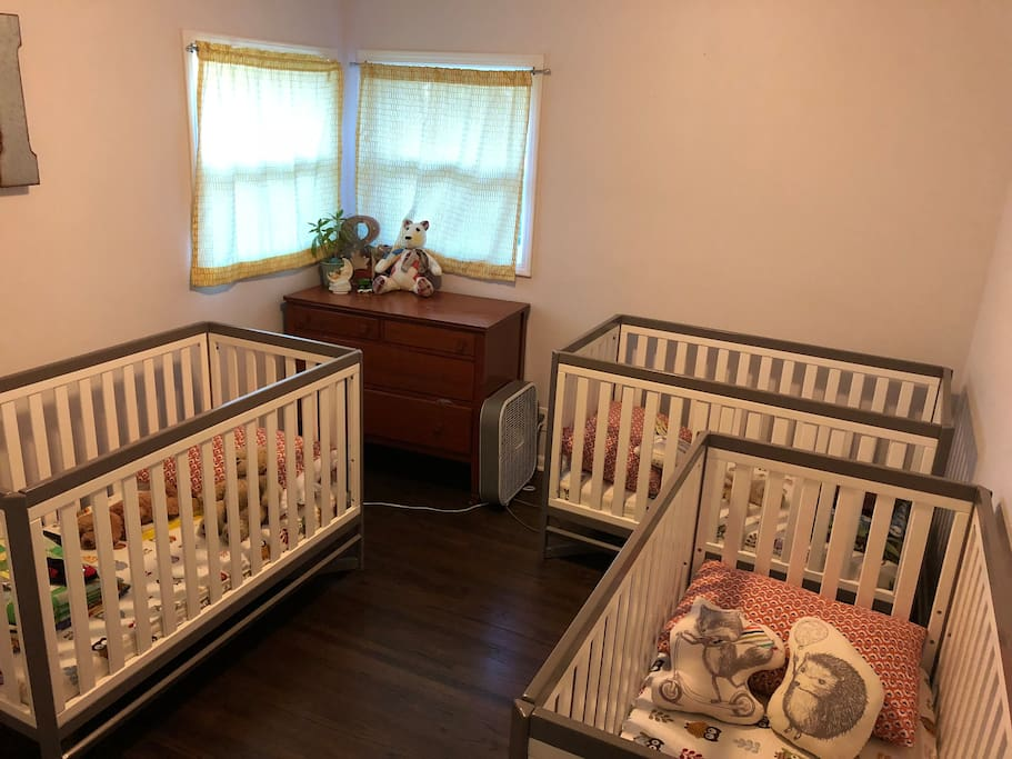 3 cribs set up - easily moved to another room for kiddos, or removed for a family who doesn't need them and would rather have an air mattress