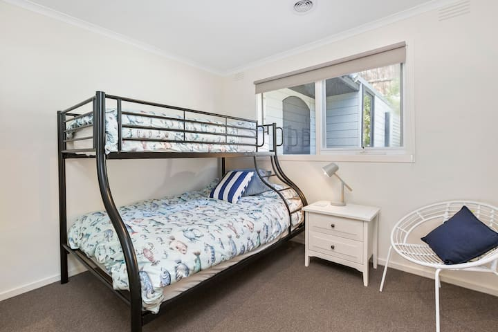 Second bedroom with tri-bunk (double mattress on the lower, single on the upper)