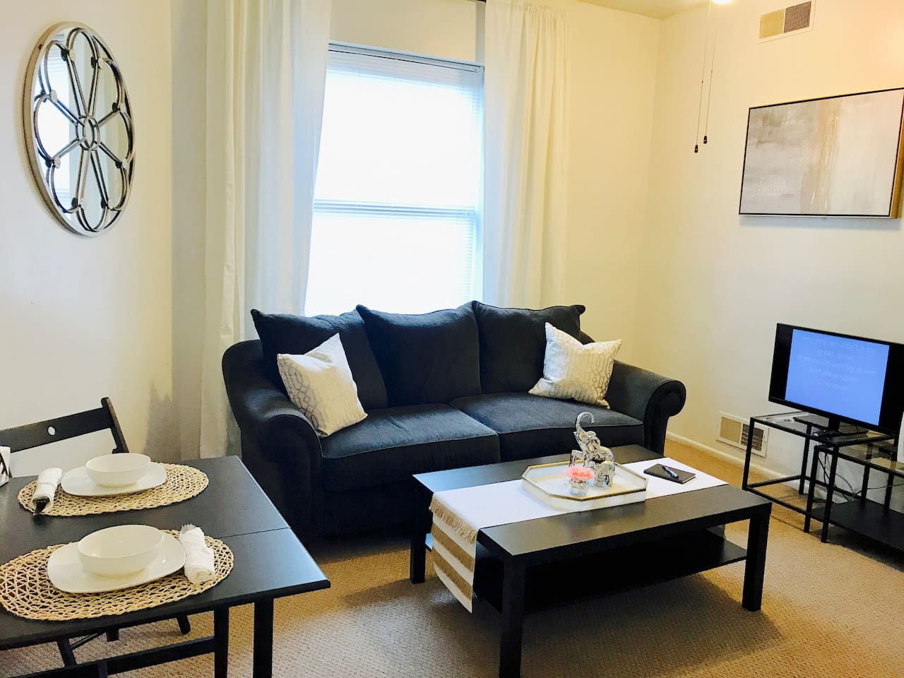 Comfy private living room includes sofa, apple tv, wifi, dining area, microwave, etc.