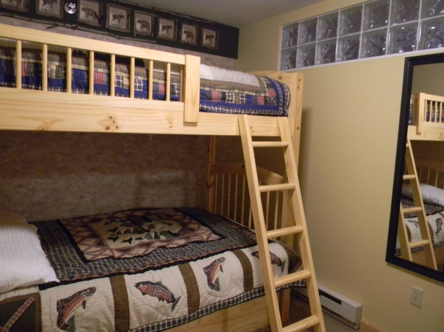 Bedroom #1 has a double bed on bottom , twin bed on top , all new plush mattresses & an extra TV.