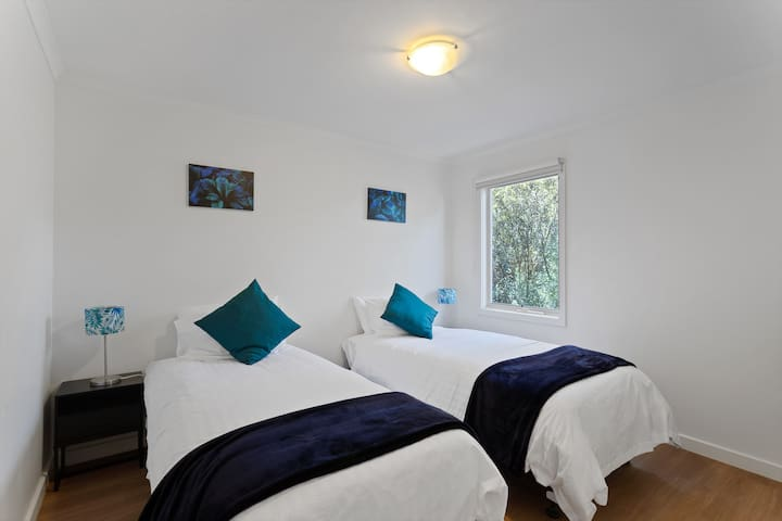 Clean and Tidy Twin Beds