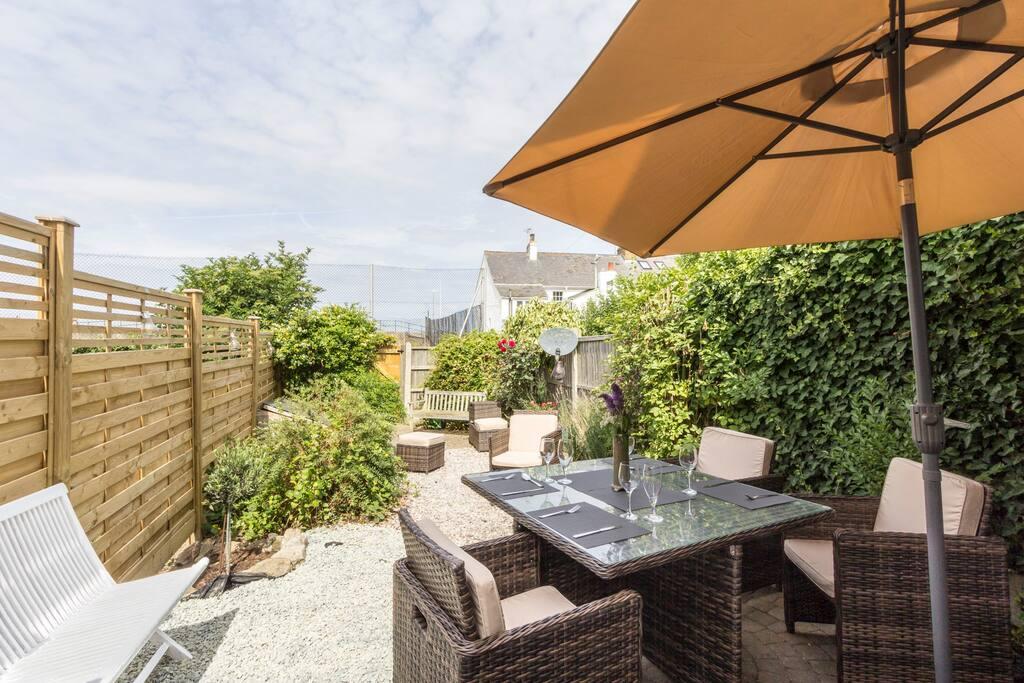 Lovely mature front garden with garden furniture