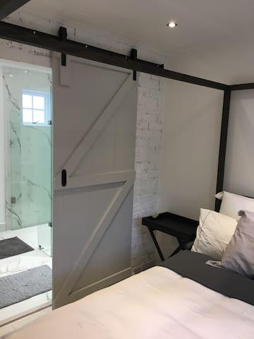 Bedroom leading to bathroom