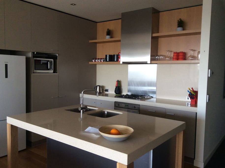 The well equipped kitchen is bright and easy to work in. Has a full sized dishwasher and oven