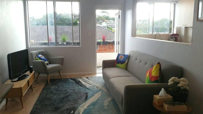 Spacious sunny + renovated 2 bedrm unit w balcony