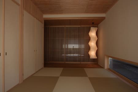 Japanese-style room (tatami). - House