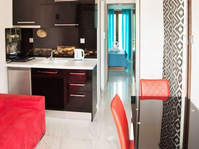 Greek Pride Apartments Family Room