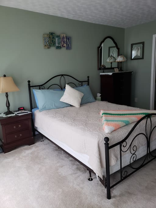 Enjoy a large, quiet, cozy, private bedroom with a nightstand that has a flashlight, in the event of a power outage and a door that locks.  Key provided upon check in.