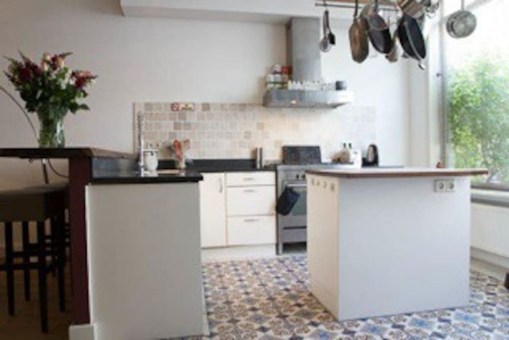 There is a spacious fully equipped kitchen.