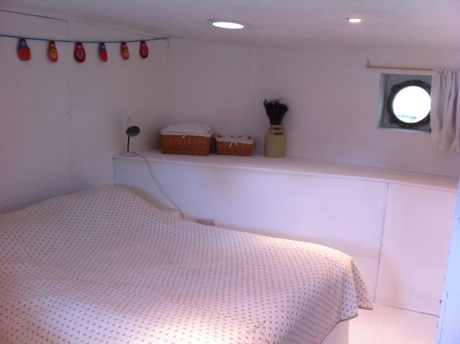 Your room - built into the curved stern. Watch ducks swim by the portholes!
