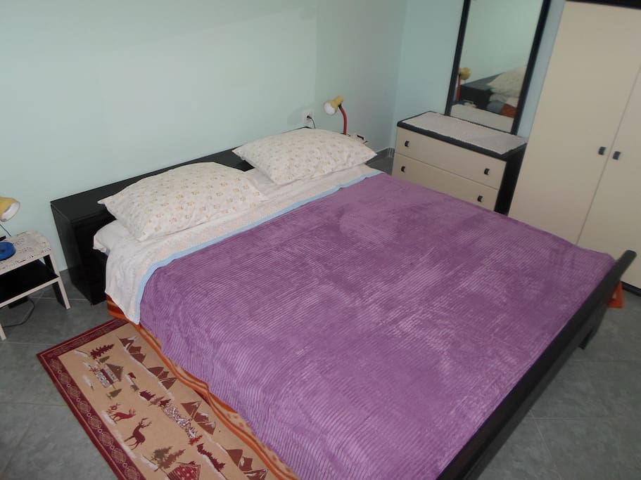 Separate bedroom with matrimonial bed
