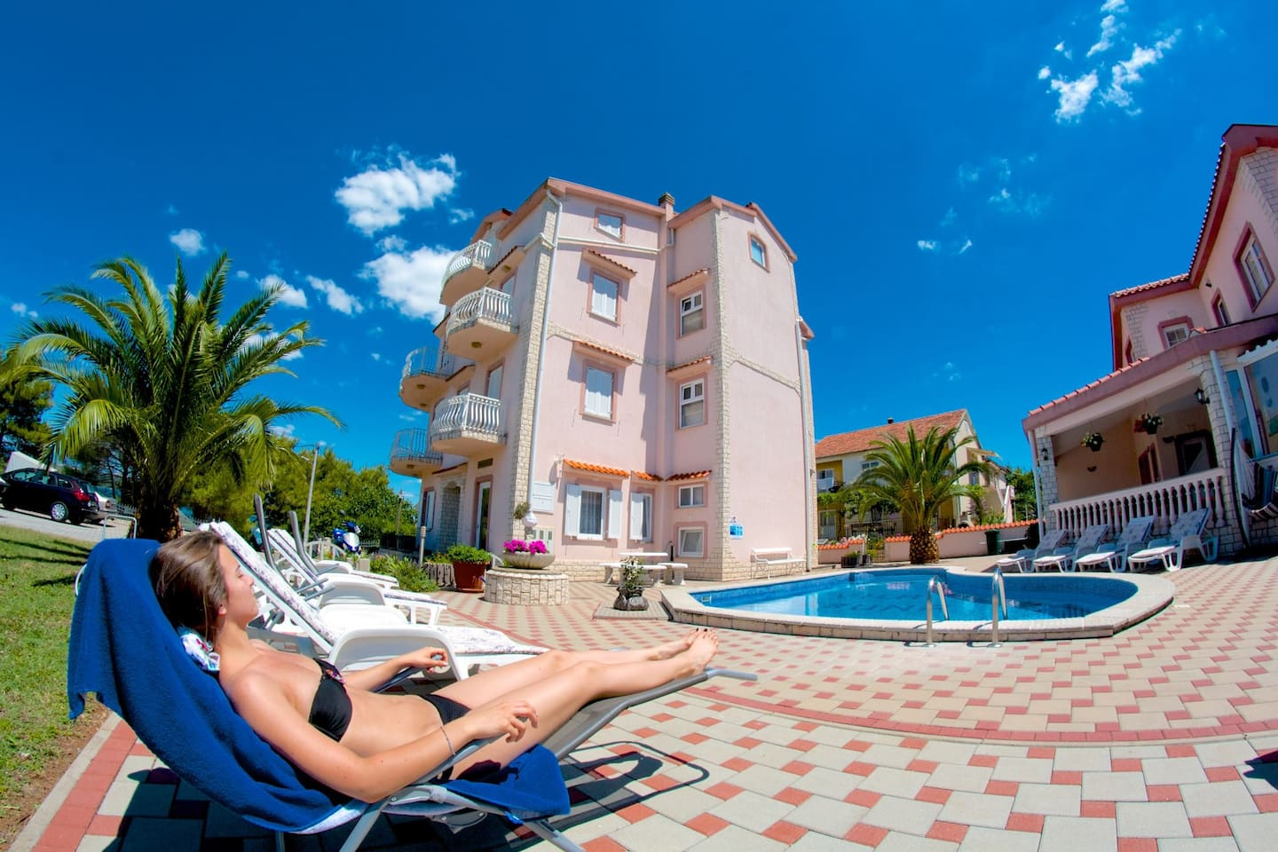 Swimming pool are and Vila Kruna and the outside terrace in the background.