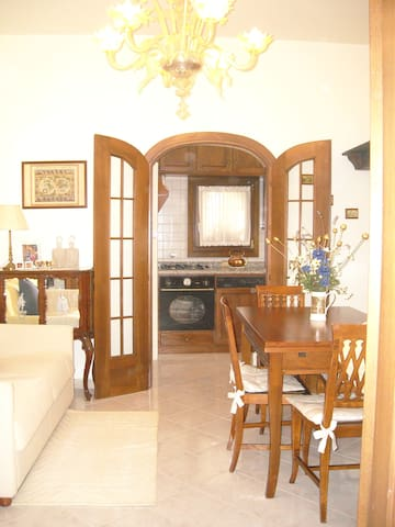 View of the sitting and dining room to the kitchen