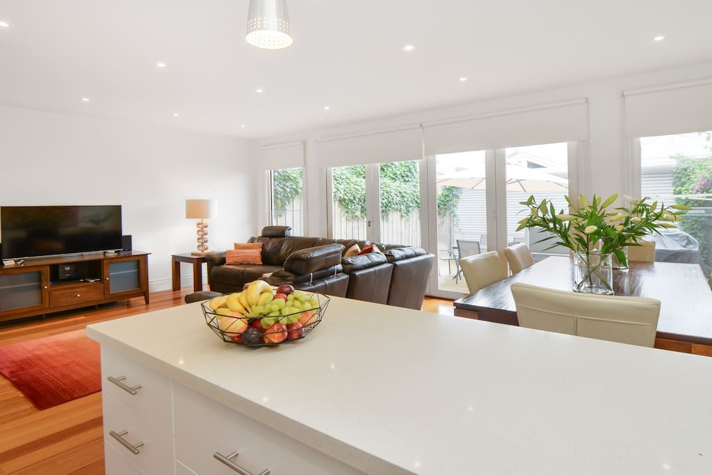 Spacious open plan living area that leads to the rear courtyard