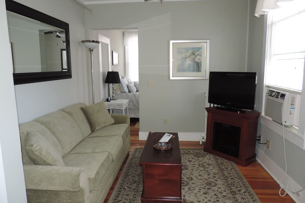 The Gorham Suite living room with flat screen TV and electric fire place!  Quaint and cozy!