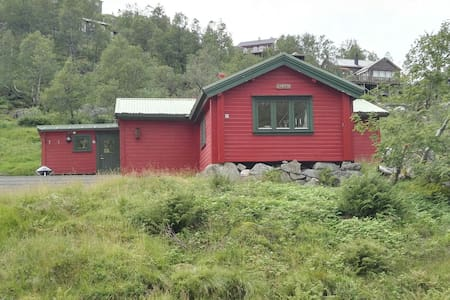 Mountain cabin by road near Preikestolen Kjerag