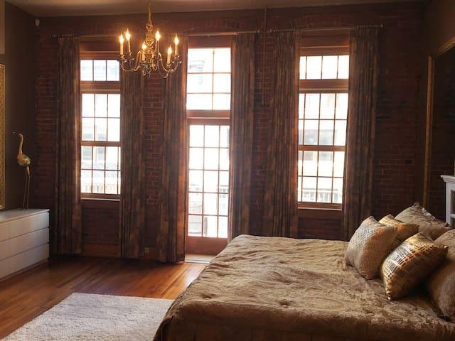 bedroom 1 - windows and door leading to balcony in master bedroom
