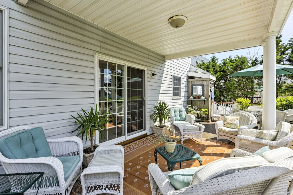 The partially covered porch is perfect for enjoying a refreshing beverage.