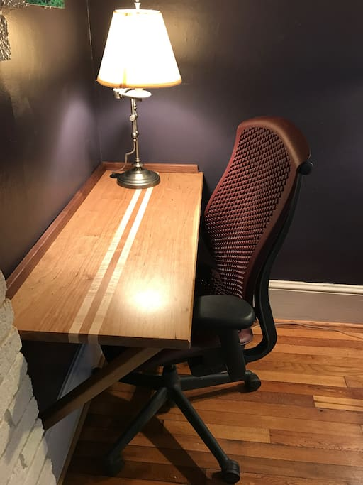 Dedicated workspace with lamp for business travelers or those needing a place to work away from home.