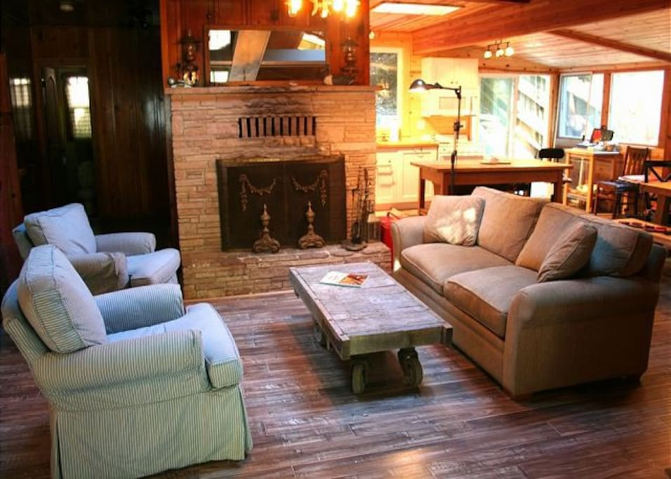 Evergreen Cottage has a stone fireplace, a sleeper sofa and two over-sized stuffed chairs