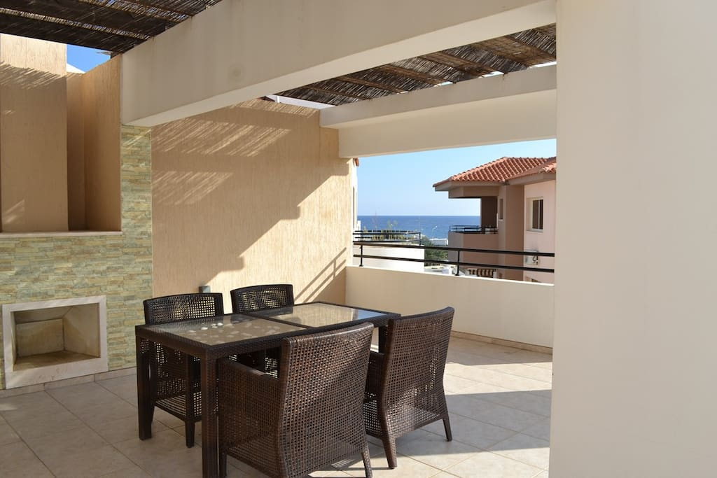 Huge balcony overlooking pool and gardens and with a sea-view and fireplace.