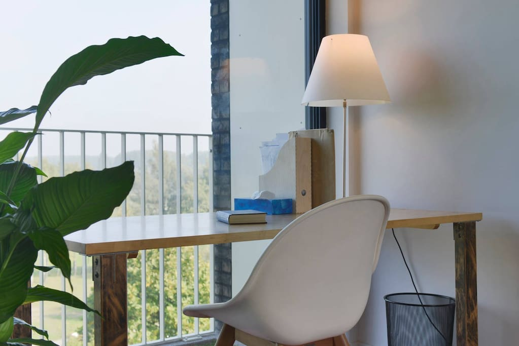 """This place is very suited for a business trip. You will have a simple single room. But you can enjoy a very nice view as you work, or prepare for your working day at this north facing desk overlooking the park """"Middenvijver"""". As this appartment is on the fifth floor, the top floor, you ar just above the tries and will see birds flying right in front of you. That is if you are not focused on work :)."""