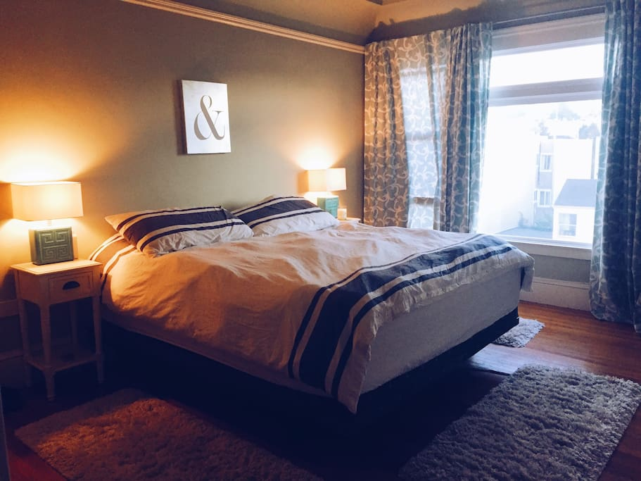 """Bedroom with King Size bed, 76"""" x 80"""" (193cm x 203cm) and it's not two beds together, it's one whole luxurious mattress :)"""
