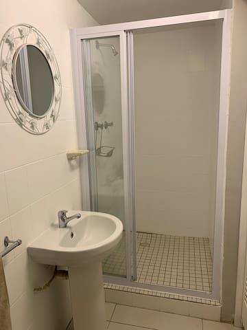 2nd bedroom's en-suite bathroom comprising shower, basin and toilet