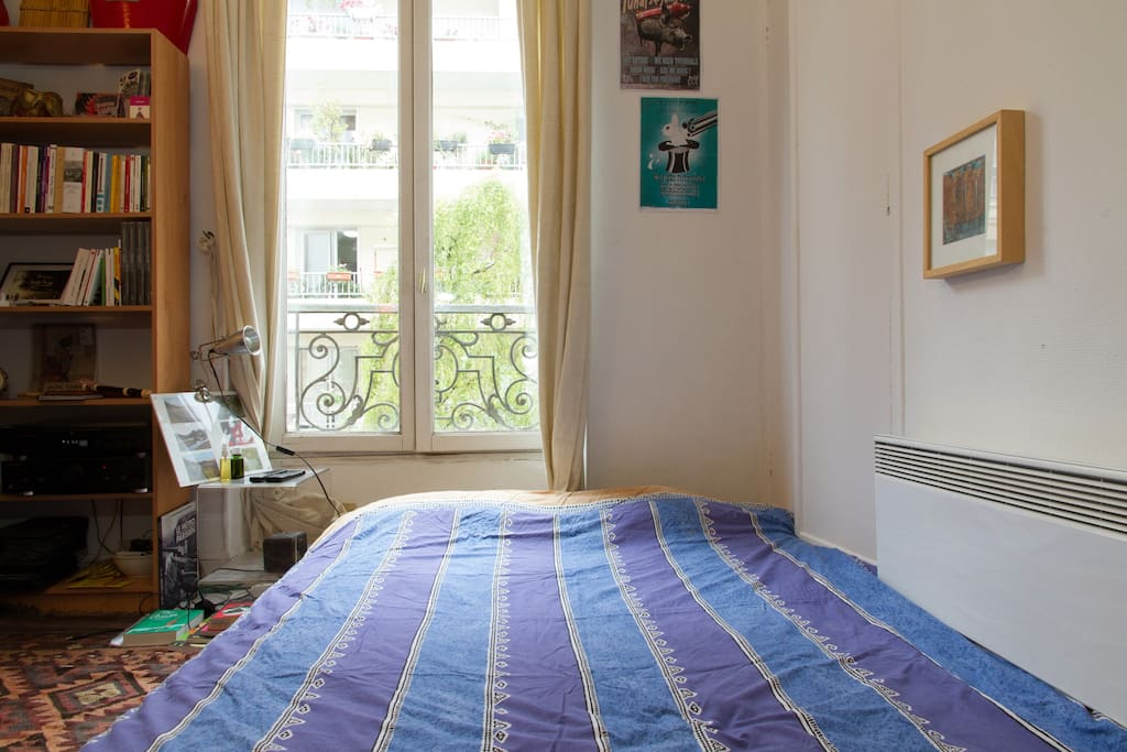 The nice bright sleeping room with the double bed