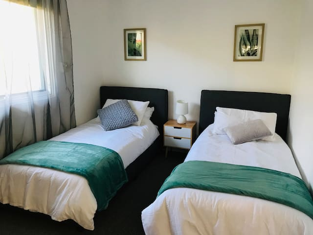 Bedroom 3 consists of two comfortable single beds with a built-in robe.