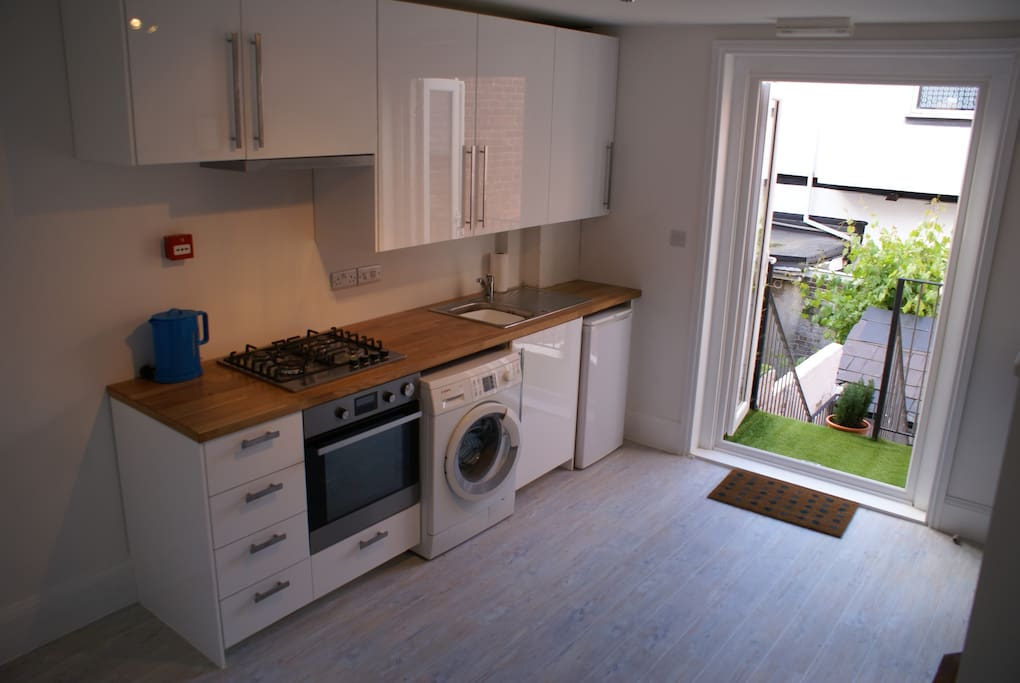 Private Kitchen. There are two bedrooms in this apartment and both benefit from sharing this private kitchen which is fully equipped with hob, oven and washing machine.
