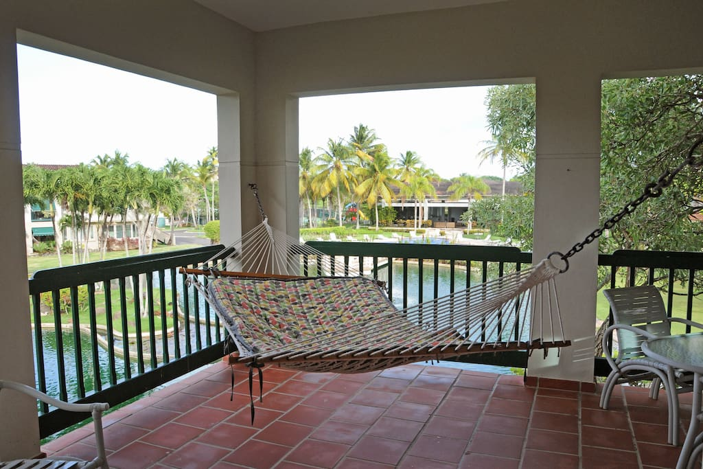 Enjoy the ocean breeze and lake and pool views from our balcony hammock.
