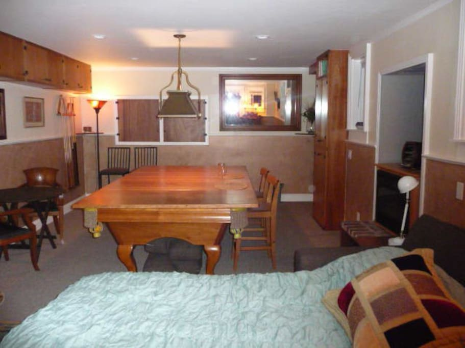 Main room with sofabed, dining table / desk (Brunswick pool table with 4-piece removable tabletop)