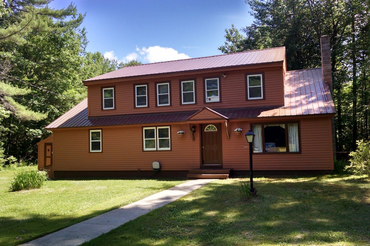 Private upstairs has two bedroom, living room with kitchenette, and bathroom.