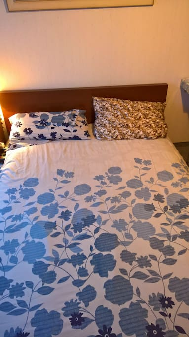 Bed with flowers bedsheet
