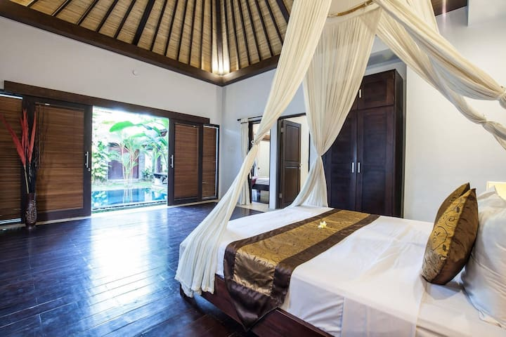 Step right into the pool from the king size bed...