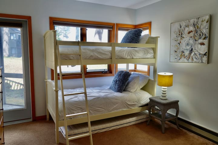 Bunk beds and an extra mattress in the other bedroom