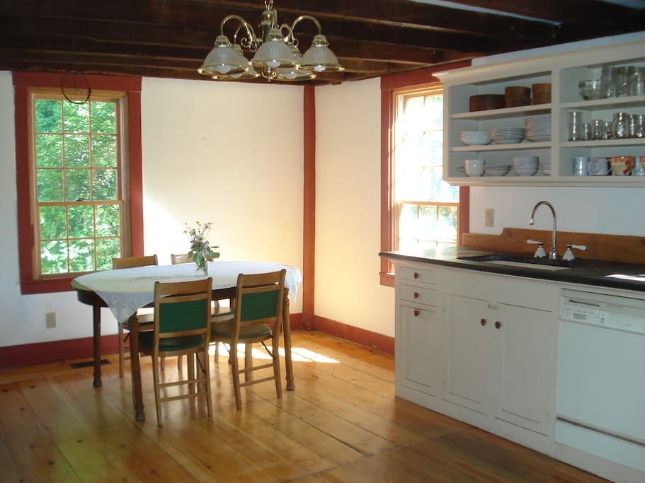 Spacious kitchen with two tables for dining