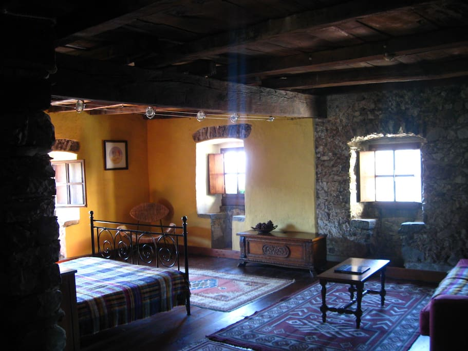 Large living area with original 16th century stone seats and ancient chestnut beams.
